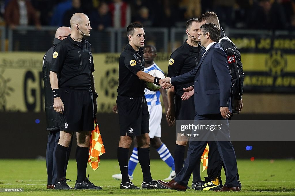 Referee Dennis Higler (CL), Coach Ruud Brood of Roda JC (R) during the Dutch Eredivisie match between Roda JC Kerkrade and PEC Zwolle at the Parkstad Limburg on Oktober 5, 2013 in Kerkrade, The Netherlands