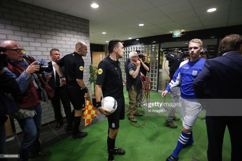 Referee Dennis Higler (C) during the Dutch Eredivisie match between Roda JC Kerkrade and PEC Zwolle at the Parkstad Limburg on Oktober 5, 2013 in Kerkrade, The Netherlands