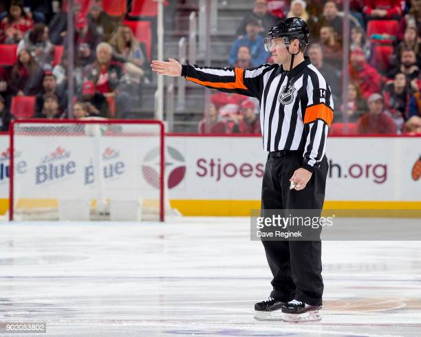 Referee Dennis LaRue signals good goal by Tom Pyatt of the Ottawa Senators during an NHL game against the Detroit Red Wings at Little Caesars Arena...