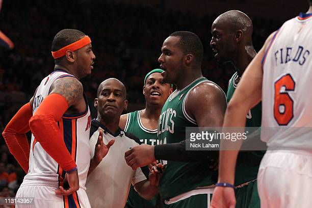 Referee Derrick Collins seperates Carmelo Anthony of the New York Knicks and Glen Davis Paul Pierce and Kevin Garnett of the Boston Celtics in Game...