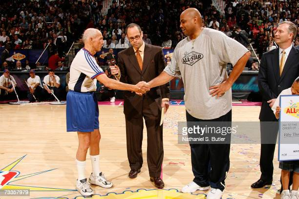 NBA referee Dick Bavetta and NBA Legend Charles Barkley shake hands after they competed against each other in a Foot Race during AllStar Saturday...