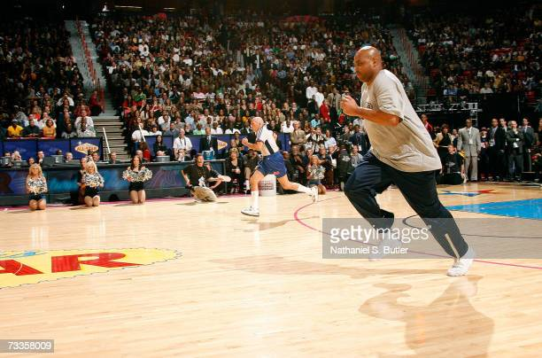 NBA referee Dick Bavetta competes against NBA legend Charles Barkley in a Foot Race during AllStar Saturday Night during the NBA AllStar Weekend on...