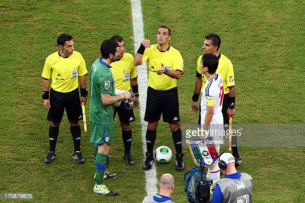 Referee Diego Abal performs the coin toss as Gianluigi Buffon of Italy and Makoto Hasebe of Japan look on prior to the FIFA Confederations Cup Brazil...