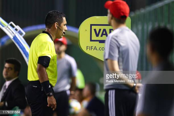 Referee Diego Haro consults the VAR during the FIFA U-17 Men's World Cup Brazil 2019 group F match between Mexico and Italy at Valmir Campelo...