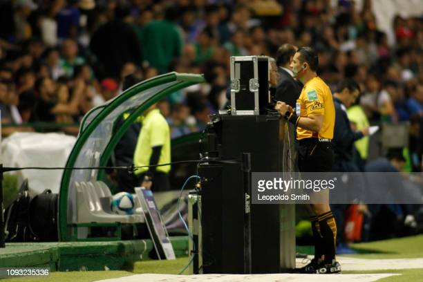 Referee Diego Montano reviews a play with the VAR during the fifth round match Leon and Cruz Azul as part of the Torneo Clausura 2019 Liga MX at Leon...