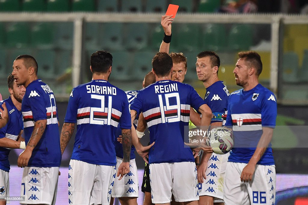 Referee Dino Tommasi shows a red card to Vasco Regini of UC Sampdoria during the Serie A match between US Citta di Palermo and UC Sampdoria at Stadio Renzo Barbera on August 31, 2014 in Palermo, Italy.