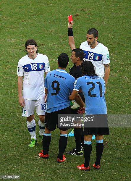 Referee Djamel Haimoud shows a red card to Riccardo Montolivo of Italy during the FIFA Confederations Cup Brazil 2013 3rd Place match between Uruguay...