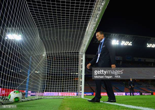 Referee Djamel Haimoudi tests the goal line technology before the FIFA Club World Cup match between Sanfrecce Hiroshima and Auckland City at...