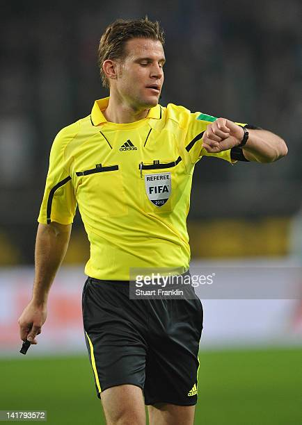 Referee Doctor Feix Bryce watches during the Bundesliga match between VfL Wolfsburg and Hamburger SV at Volkswagen Arena on March 23 2012 in...