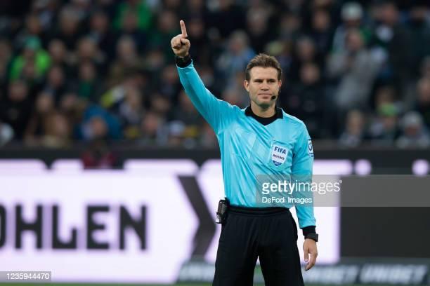 Referee Dr. Felix Brych gestures during the Bundesliga match between Borussia Mönchengladbach and VfB Stuttgart at Borussia-Park on October 16, 2021...
