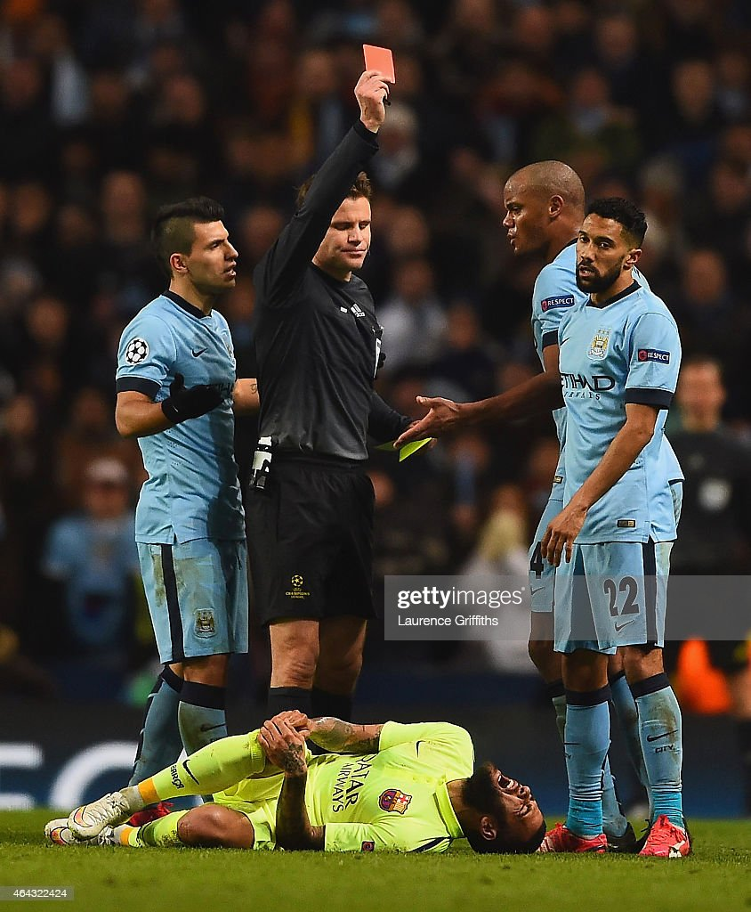 Referee Dr. Felix Brych shows Gael Clichy of Manchester City a red card during the UEFA Champions League Round of 16 match between Manchester City and Barcelona at Etihad Stadium on February 24, 2015 in Manchester, United Kingdom.