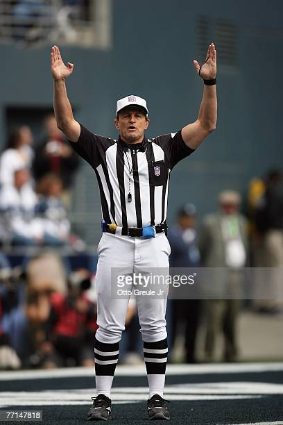 Referee Ed Hochuli signals during the Seattle Seahawks game against the Cincinnati Bengals at Qwest Field on September 23 2007 in Seattle Washington...