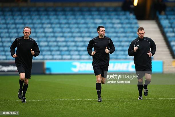 Referee Eddie Ilderton warms up with assistant referees Ian Cooper and Robert Whitton ahead of the Sky Bet Championship match between Millwall and...
