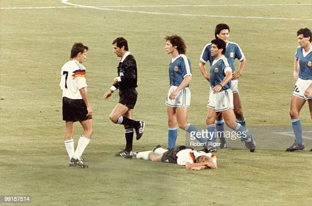 Referee Edgardo Codesal Mendez walks away after giving a red card to Pedro Monzon of Argentina for a foul on Jurgen Klinsmann of West Germany during...