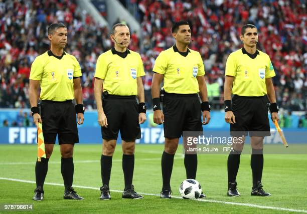 Referee Enrique Caceres Assistant Referee Eduardo Cardozo Assistant Referee Juan Zorrilla and fourth Official Cuneyt Cakirduring are seen prior to...