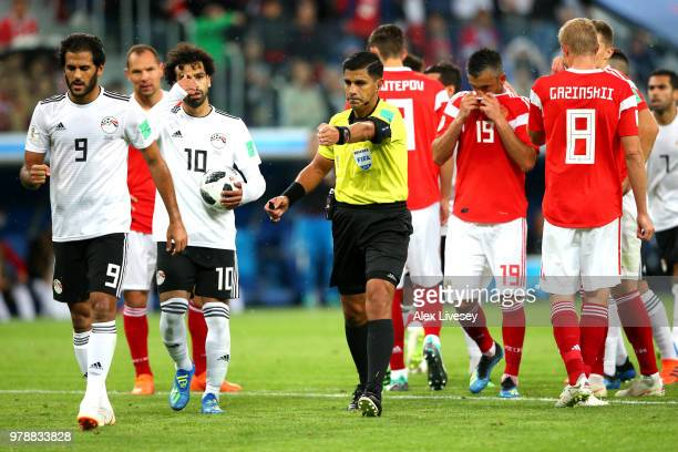 Referee Enrique Caceres awards Egypt a penalty after consulting VAR during the 2018 FIFA World Cup Russia group A match between Russia and Egypt at...