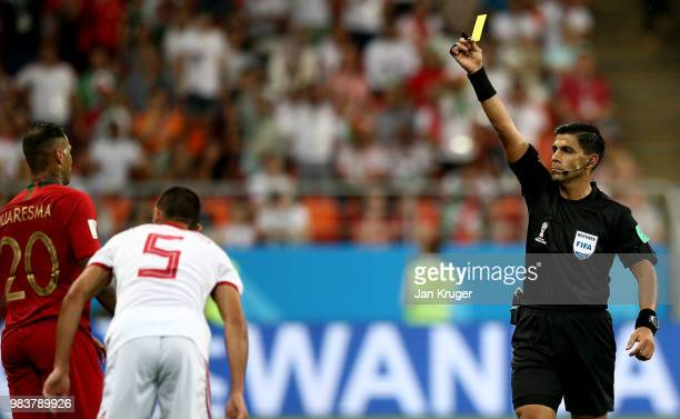 Referee Enrique Caceres books Ricardo Quaresma of Portugal during the 2018 FIFA World Cup Russia group B match between Iran and Portugal at Mordovia...