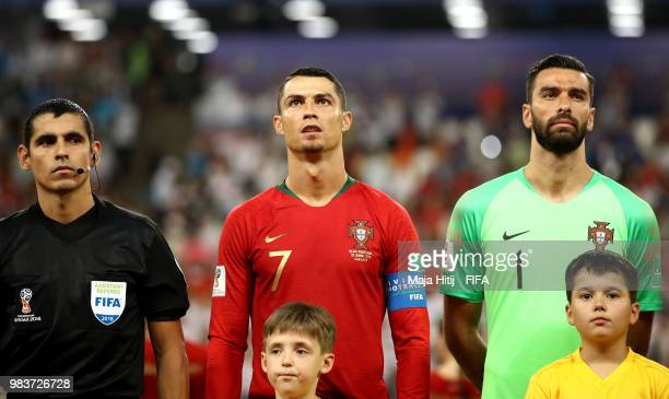 Referee Enrique Caceres Cristiano Ronaldo and Rui Patricio of Portugal look on prior to the 2018 FIFA World Cup Russia group B match between Iran and...