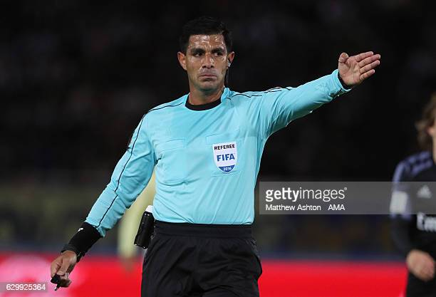 Referee Enrique Caceres gestures during the FIFA Club World Cup Semi Final match between Club America and Real Madrid at International Stadium...