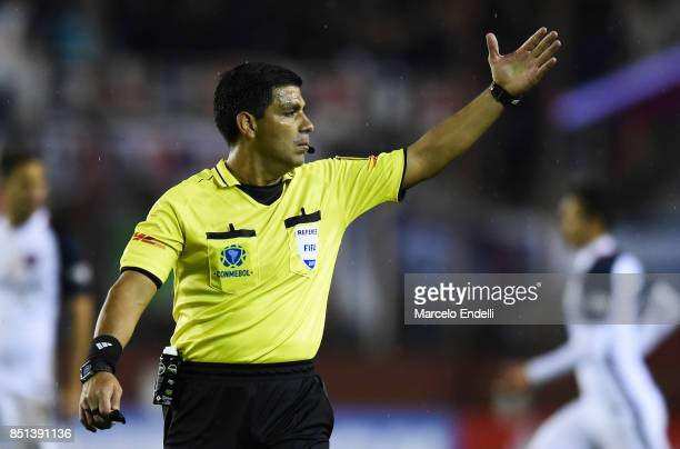 Referee Enrique Caceres gestures during the second leg match between Lanus and San Lorenzo as part of the quarter finals of Copa Conmebol...