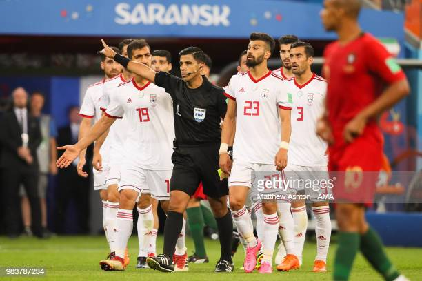 Referee Enrique Caceres gestures to the Iran players after awarding a penalty to Portugal during the 2018 FIFA World Cup Russia group B match between...