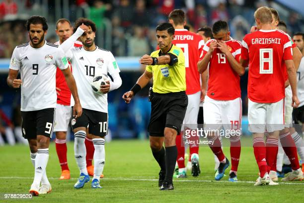 Referee Enrique Caceres gives a penalty after consulting VAR during the 2018 FIFA World Cup Russia group A match between Russia and Egypt at Saint...