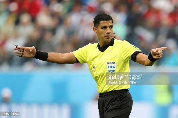 Referee Enrique Caceres gives instruction during the 2018 FIFA World Cup Russia group A match between Russia and Egypt at Saint Petersburg Stadium on...