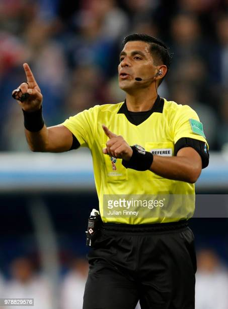 Referee Enrique Caceres makes a point during the 2018 FIFA World Cup Russia group A match between Russia and Egypt at Saint Petersburg Stadium on...