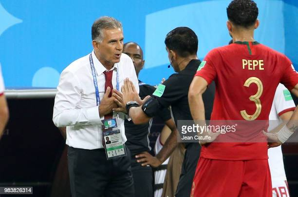 Referee Enrique Caceres of Paraguay calms down coach of Iran Carlos Queiroz during the 2018 FIFA World Cup Russia group B match between Iran and...