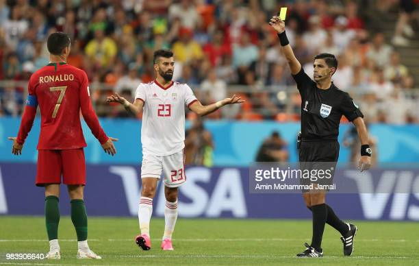 Referee Enrique Caceres shows a yellow card to Cristiano Ronaldo of Portugal during the 2018 FIFA World Cup Russia group B match between Iran and...