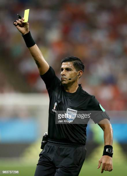 Referee Enrique Caceres shows a yellow cardduring the 2018 FIFA World Cup Russia group B match between Iran and Portugal at Mordovia Arena on June 25...