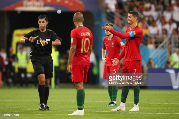 Referee Enrique Caceres shows Cristiano Ronaldo of Portugal a yellow card during the 2018 FIFA World Cup Russia group B match between Iran and...