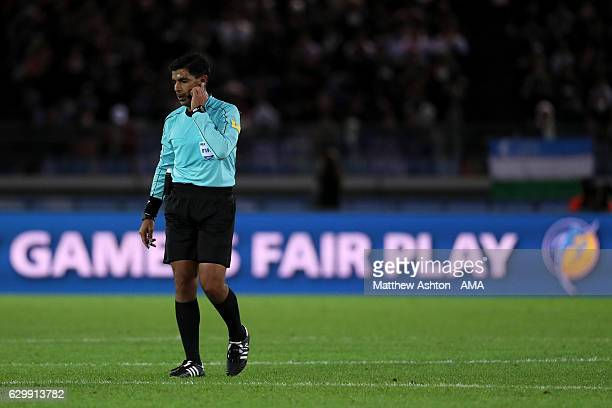 Referee Enrique Caceres speaks to the video Assistant Referee after Real Madrid's second goal during the FIFA Club World Cup Semi Final match between...