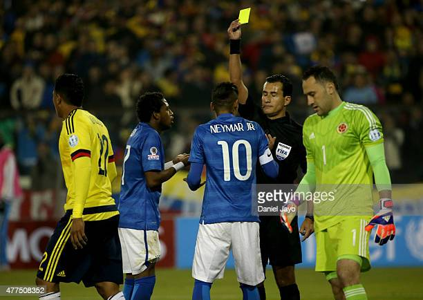 Referee Enrique Osses shows a yellow card to Neymar of Brazil during the 2015 Copa America Chile Group C match between Brazil and Colombia at...