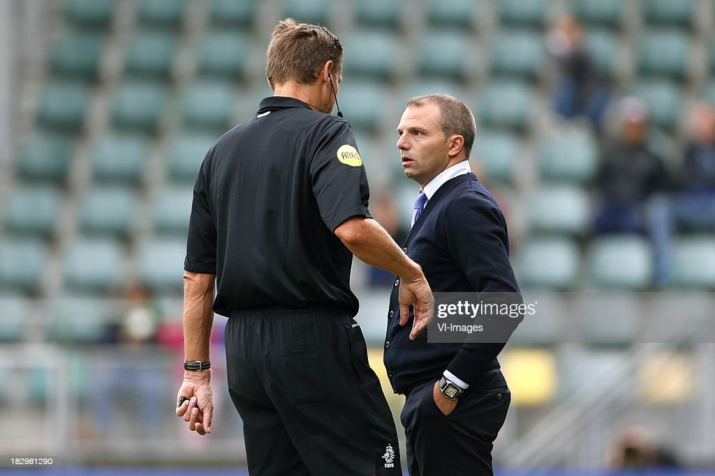 Referee Eric Braamhaar, Coach Maurice Steijn of ADO Den Haag during the Dutch Eredivisie match between ADO Den Haag and Vitesse on Oktober 2, 2013 at the Kyocera stadium in The Hague, The Netherlands.