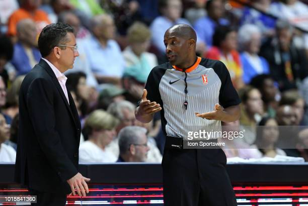 Referee Eric Brewton speaks with Connecticut Sun head coach Curt Miller during a WNBA game between Chicago Sky and Connecticut Sun on August 12 at...