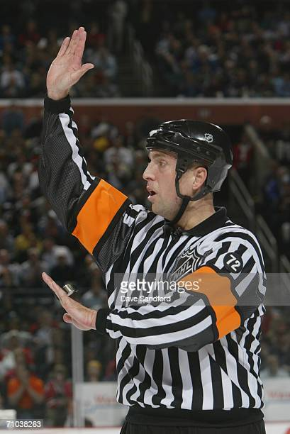 Referee Eric Furlatt signals in game four of the Eastern Conference Semifinals between the Buffalo Sabres and the Ottawa Senators during the 2006 NHL...