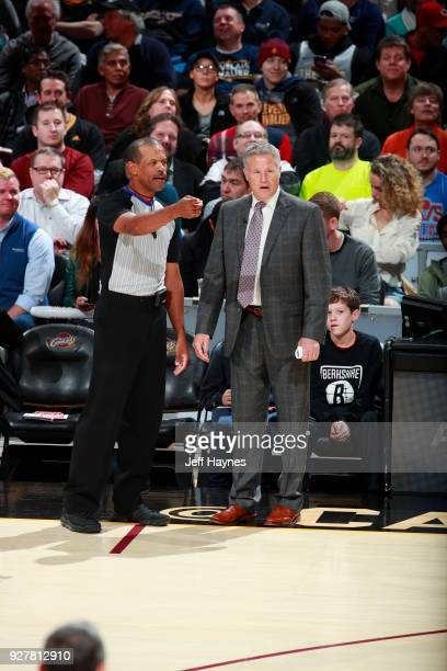 Referee Eric Lewis and Head Coach Brett Brown of the Philadelphia 76ers discuss a call during the game against the Cleveland Cavaliers on March 1...