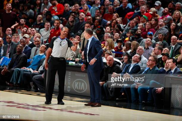 Referee Eric Lewis and Head Coach Tyronn Lue of the Cleveland Cavaliers discuss a call during the game against the Philadelphia 76ers on March 1 2018...
