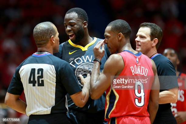 Referee Eric Lewis issues Rajon Rondo of the New Orleans Pelicans a technical foul after an altercation with Draymond Green of the Golden State...