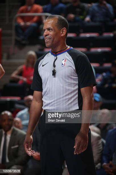 Referee Eric Lewis looks on during a game between the Cleveland Cavaliers and the Detroit Pistons on October 25 2018 at Little Caesars Arena in...