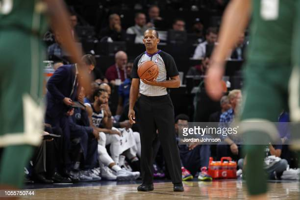 Referee Eric Lewis looks on during the Milwaukee Bucks game against the Minnesota Timberwolves on October 26 2018 at Target Center in Minneapolis...