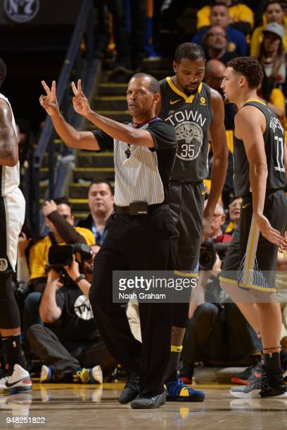 Referee Eric Lewis makes a call during Game Two of Round One of the 2018 NBA Playoffs between the Golden State Warriors and San Antonio Spurs on...