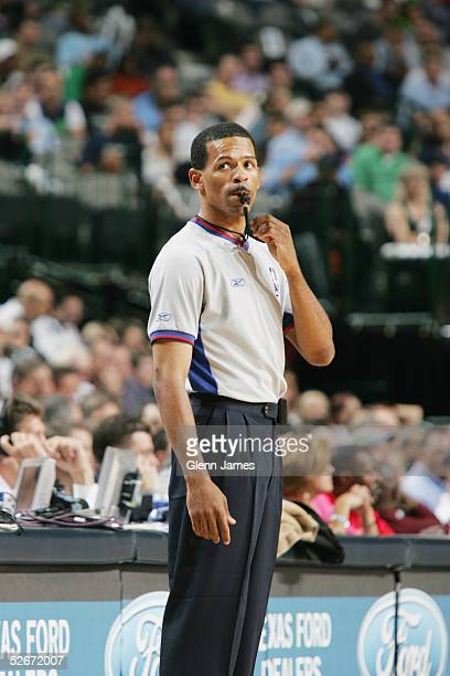 Referee Eric Lewis stands on the court during the game between the Dallas Mavericks and Orlando Magic at American Airlines Arena on April 5 2005 in...