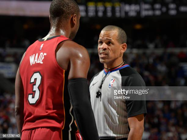 NBA referee Eric Lewis talks with Dwyane Wade of the Miami Heat during the game against the Philadelphia 76ers in Game Five of Round One of the 2018...