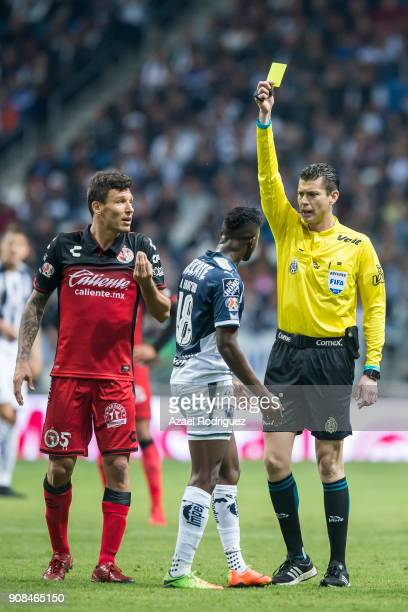 Referee Erick Miranda gives a yellow card to Aviles Hurtado of Monterrey during the third round match between Monterrey and Tijuana as part of Torneo...