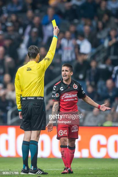 Referee Erick Miranda gives a yellow card to Damian Perez of Tijuana during the third round match between Monterrey and Tijuana as part of Torneo...
