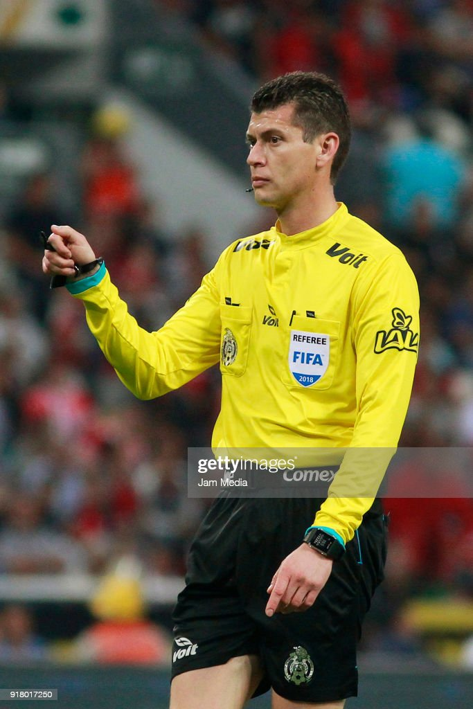 Referee Erick Yahir Miranda gestures during the 7th round match between Atlas and Necaxa as part of the Torneo Clausura 2018 Liga MX at Jalisco Stadium on February 13, 2018 in Guadalajara, Mexico.