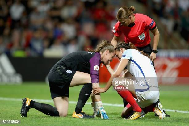 Referee Esther Staubli and Jill Scott of England check that Karen Bardsley of England is okay after going down with a injury during the UEFA Women's...