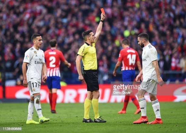 Referee Estrada Fernandez shows a red card and sends off Thomas Partey of Atletico Madrid during the La Liga match between Club Atletico de Madrid...